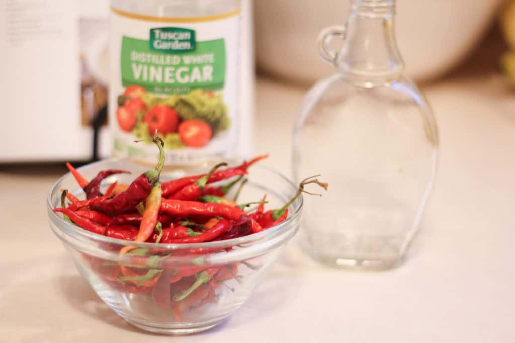 red cayenne peppers in clear glass bowl