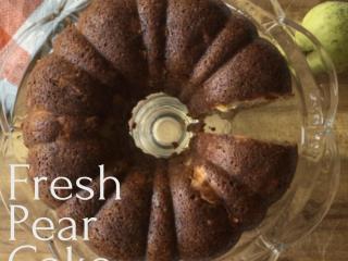 fresh pear cake on pedestal