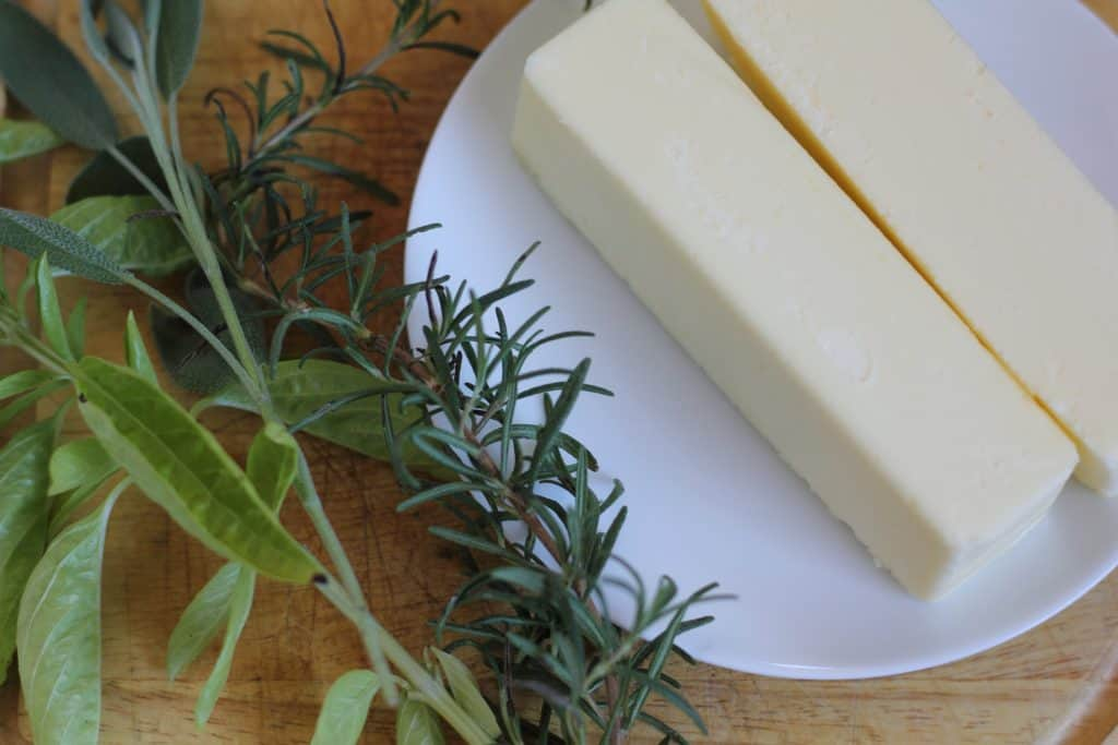 sticks of butter and fresh herbs