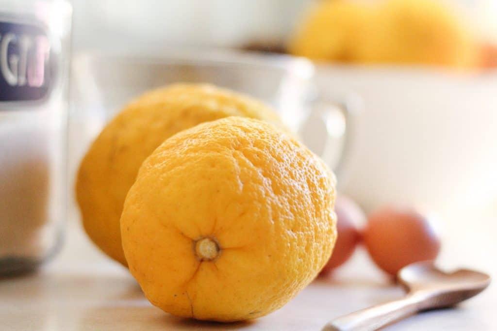 lemons, sugar, and egg on counter