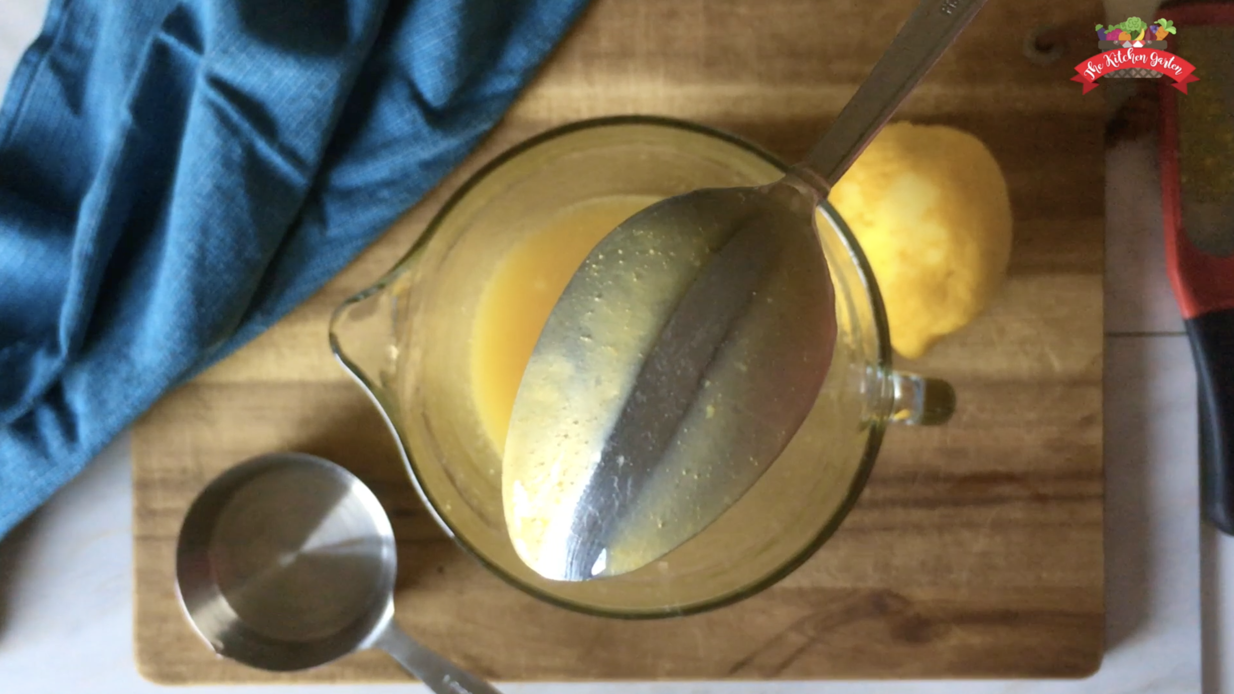 microwave lemon curd coating the back of a spoon