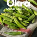 fresh okra on a kitchen cloth with a red border