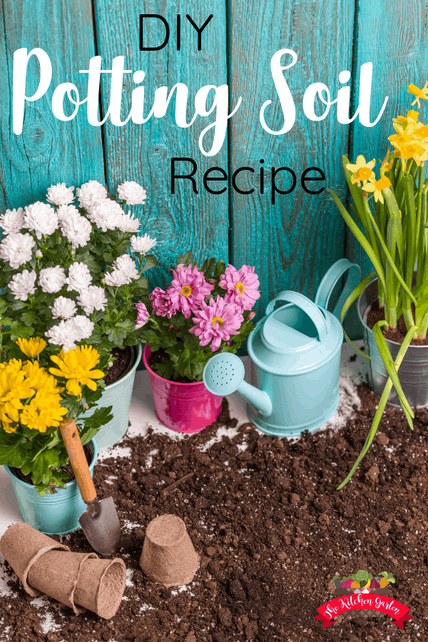 potting soil with flowers in pots and a watering can