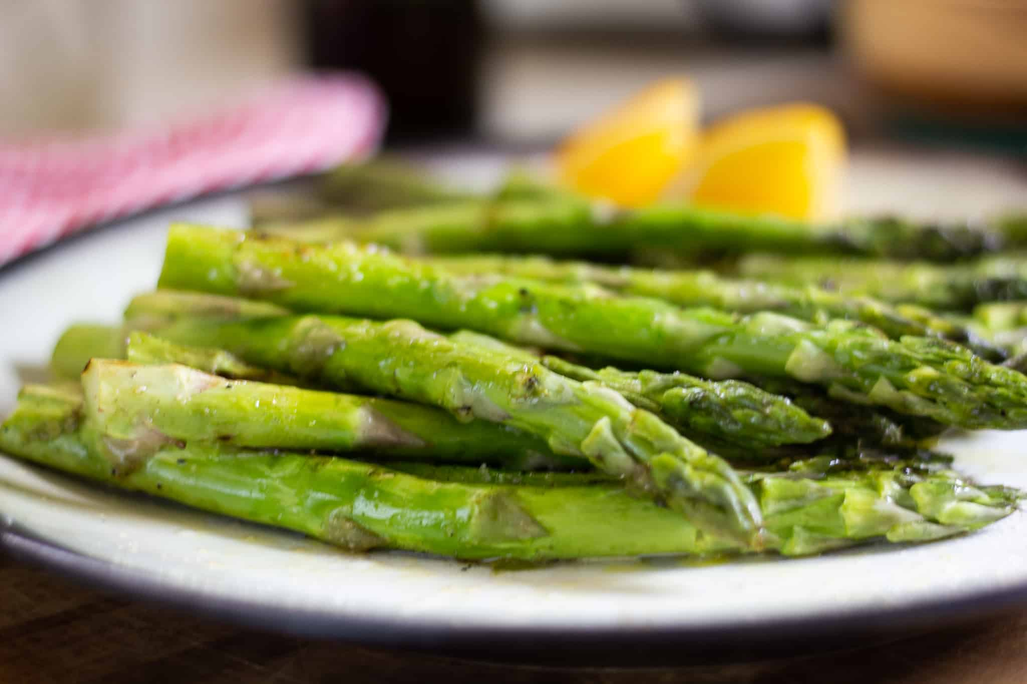 Grilled asparagus on plate with lemon