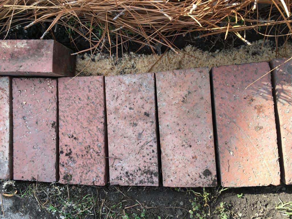 brick flower bed edging begin installed