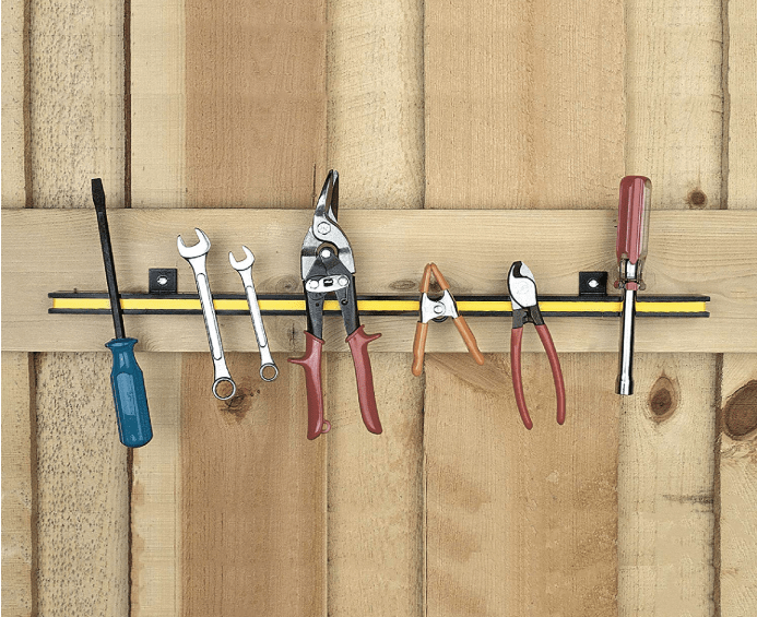 tools hanging on a magnetic strip