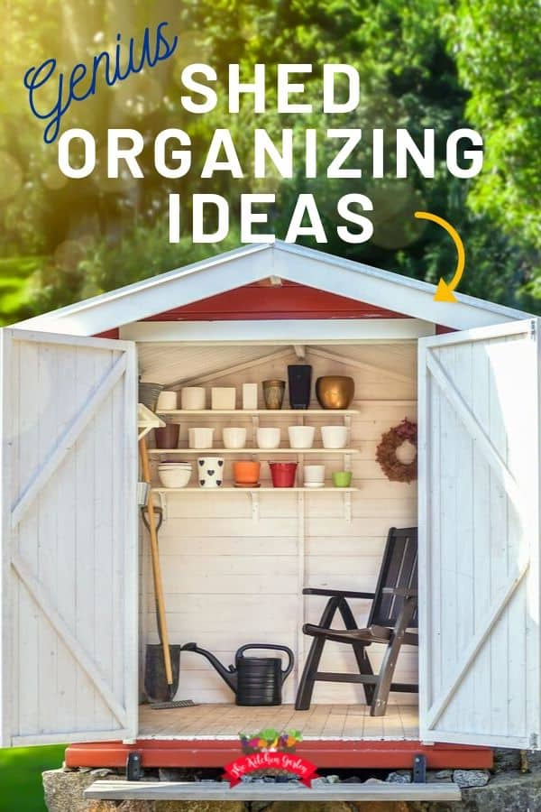 white shed with open doors and shelves of potting supplies
