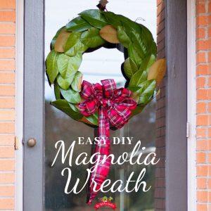 green magnolia wreath on glass door