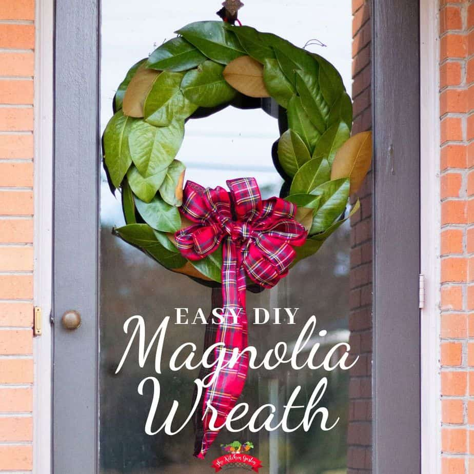 green magnolia wreath on glass door