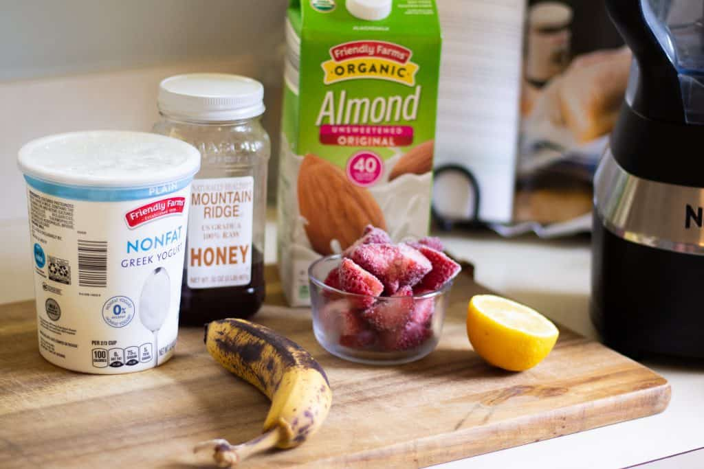 strawberry smoothie ingredients on counter