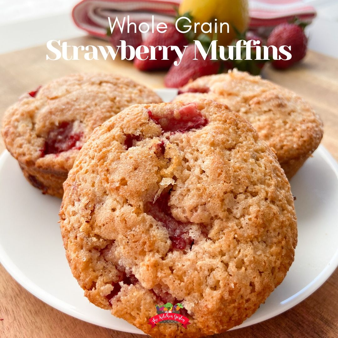 whole grain strawberry muffins on white plate