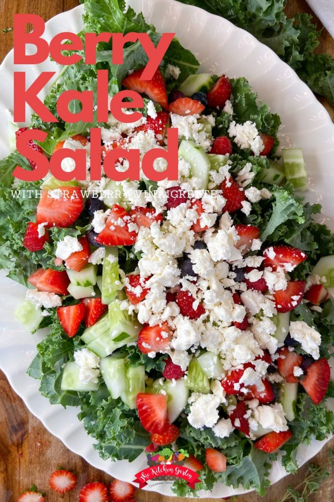 Berry kale salad with strawberry vinaigrette on a white platter