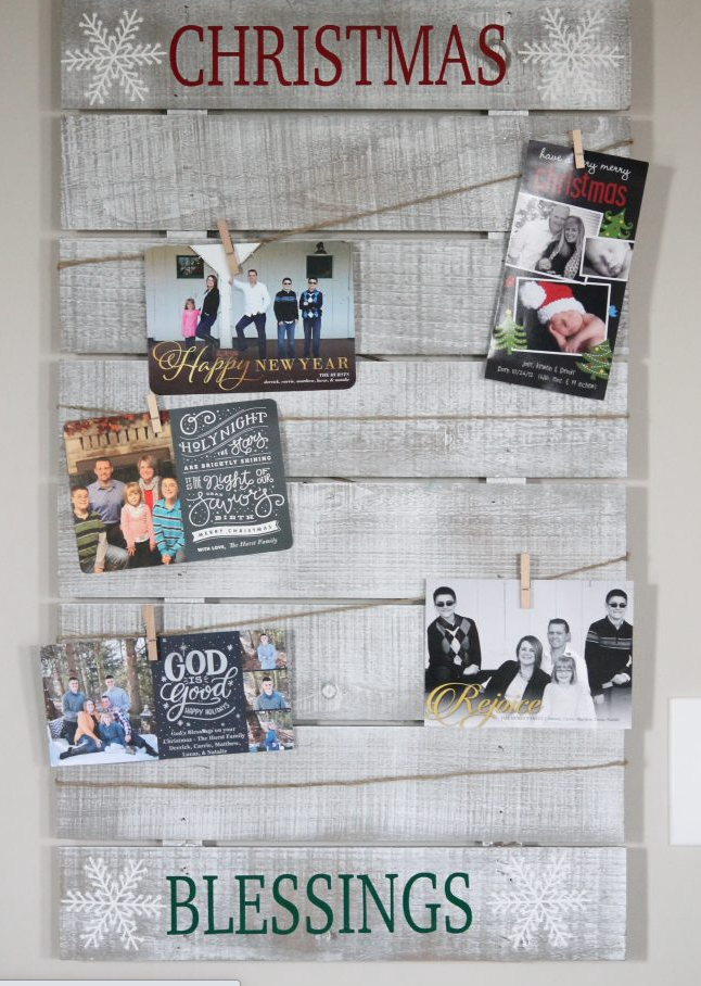 rustic Christmas card display with cards hanging on twine