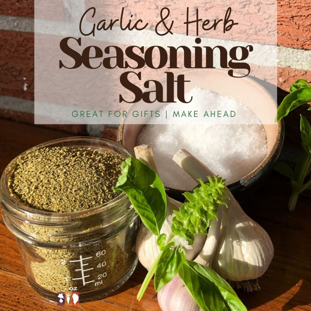 garlic and herb salt in a glass jar on a wooden table